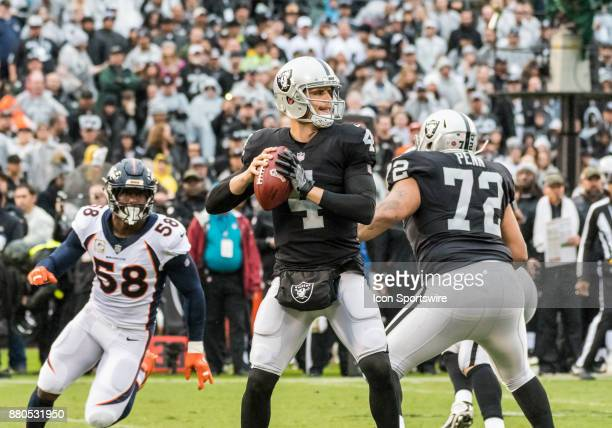 Oakland Raiders quarterback Derek Carr targeting a receiver during the game between the Denver Broncos verses the Oakland Raiders on Sunday November...