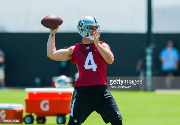 Oakland Raiders quarterback Derek Carr throws to wide receivers durings the Oakland Raiders OTA at the Raiders Training Facility in AlamedaCA on May...