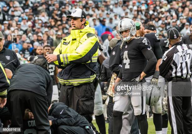 Oakland Raiders quarterback Derek Carr watches with concern as medics attend to Oakland Raiders wide receiver Amari Cooper during the game between...