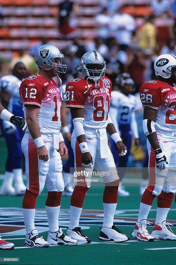 3945f1582dc Oakland Raiders quarterback Rich Gannon and wide receiver Tim Brown ...