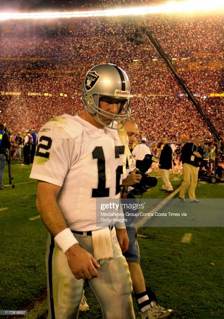 Oakland Raiders quarterback Rich Gannon walks off the field as confetti falls for the Tampa Bay Buccaneers after the Raiders lost Super Bowl XXXVII  at Qualcom Stadium in San Diego, Calif., Sunday Jan. 26, 2003. The Bucs beat the Raiders 48-21.(KARL MONDO : News Photo