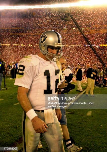 Oakland Raiders quarterback Rich Gannon walks off the field as confetti falls for the Tampa Bay Buccaneers after the Raiders lost Super Bowl XXXVII...