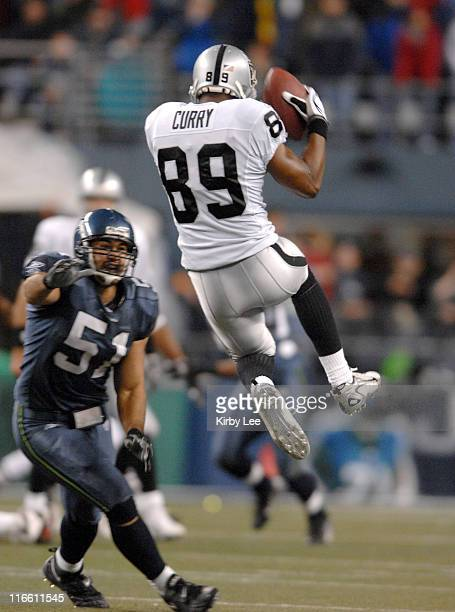 Oakland Raiders receiver Ronald Curry makes a leaping catch during ESPN Monday Night Football game against the Seattle Seahawks at Qwest Field in...