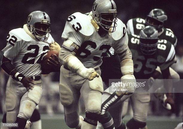 Oakland Raiders running back Arthur Whittington on a carry down field with the help of Oakland Raiders Hall of Fame guard Gene Upshawin in a 2710 win...