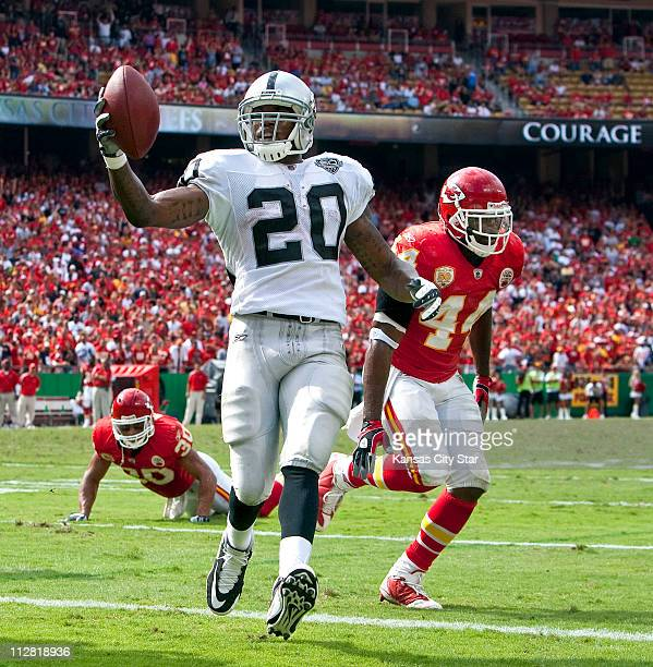 Oakland Raiders running back Darren McFadden crosses the goal line for a touchdown against Kansas City Chiefs safety Jarrad Page in the fourth...