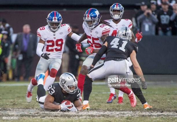 Oakland Raiders running back DeAndre Washington gets the ball to seal the 2417 victory against the New York Giants on Sunday Dec 3 2017 at the...