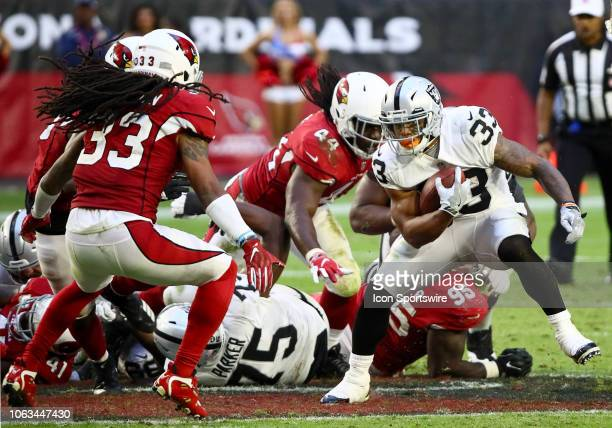 Oakland Raiders running back DeAndre Washington runs the ball in traffic during the NFL football game between the Arizona Cardinals and the Oakland...
