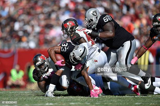 Oakland Raiders Running Back DeAndre Washington tries to avoid the tackle by Tampa Bay Buccaneers Defensive End Robert Ayers during an NFL football...