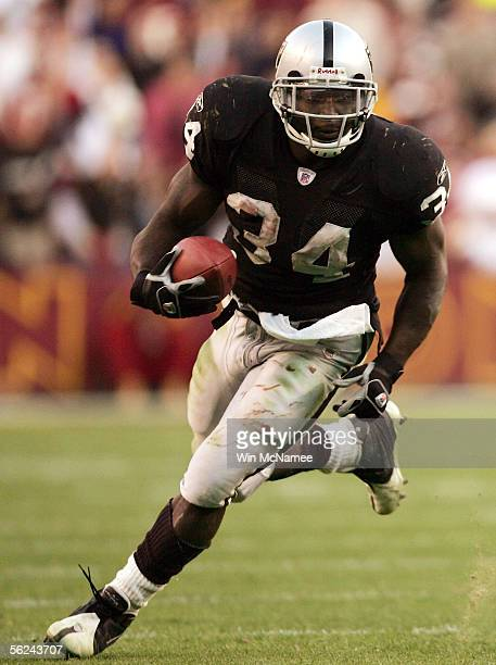 Oakland Raiders running back LaMont Jordan carries the ball upfield against the Washington Redskins in the fourth quarter on November 20, 2005 at Fed...