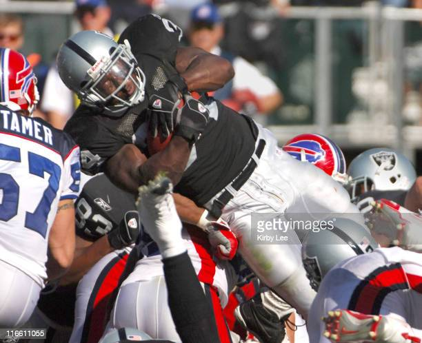 Oakland Raiders running back LaMont Jordan dives into the end zone to score on a 1yard run in the second quarter of 3817 victory over the Buffalo...