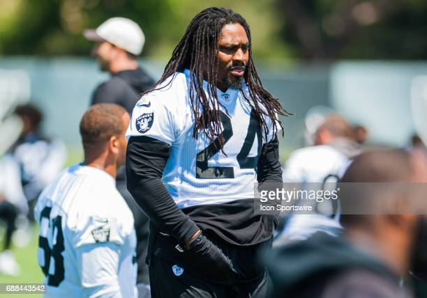 Oakland Raiders running back Marshawn Lynch appears to be in good spirits during the Oakland Raiders OTA at the Raiders Training Facility in...