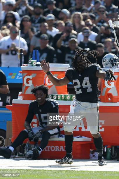Oakland Raiders running back Marshawn Lynch expresses himself on the sideline as teammate Michael Crabtree looks on in the background during an NFL...