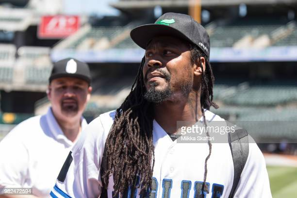 Oakland Raiders running back Marshawn Lynch plays in Water For Life Charity Softball Game at OaklandAlameda County Coliseum on June 23 2018 in...