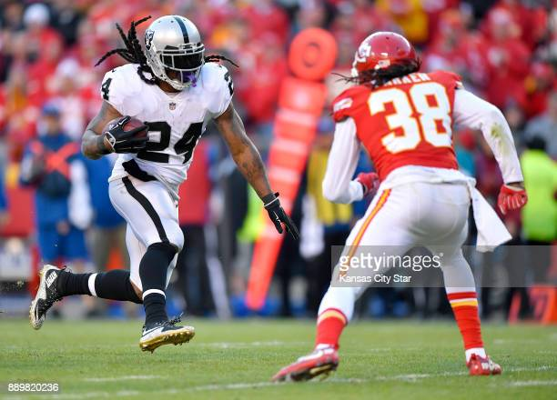Oakland Raiders running back Marshawn Lynch runs past Kansas City Chiefs free safety Ron Parker for a touchdown in the fourth quarter on Sunday Dec...