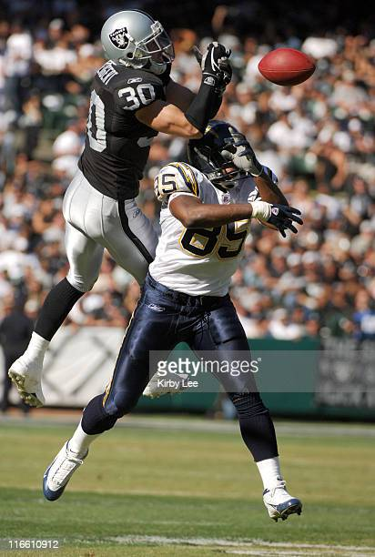 Oakland Raiders safety Stuart Schweigert is called for pass interference while trying to break up a pass intended for San Diego Chargers tight end...