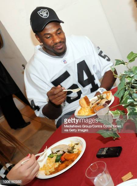 Oakland Raiders Sam Williams has a Thanksgiving dinner at a group home for teenage girls in San Ramon Calif on Wednesday Nov 24 2010 Raiders Bruce...