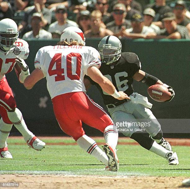 Oakland Raiders starting running back Napoleon Kaufman runs after catching a pass but is tackled by Arizona Cardinals Pat Tillman just shy of a first...
