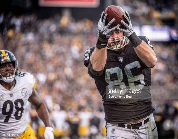 Oakland Raiders tight end Lee Smith makes a catch for a touchdown against Pittsburgh Steelers inside linebacker Vince Williams on Sunday Dec 9 2018...