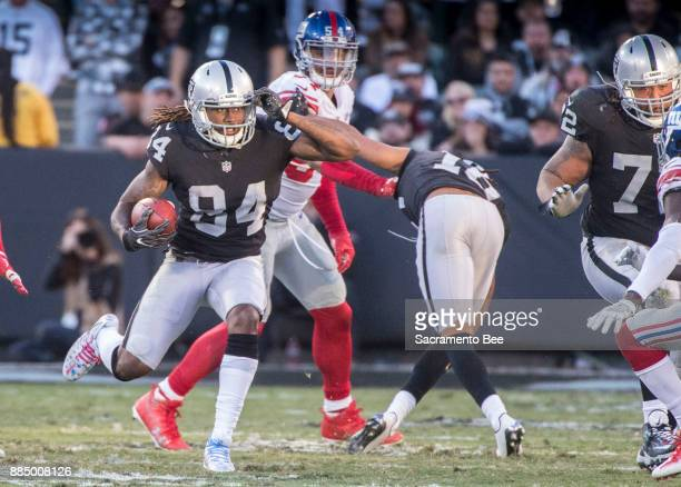 Oakland Raiders wide receiver Cordarrelle Patterson finds a hole to make his way to a long first down against the New York Giants on Sunday Dec 3...