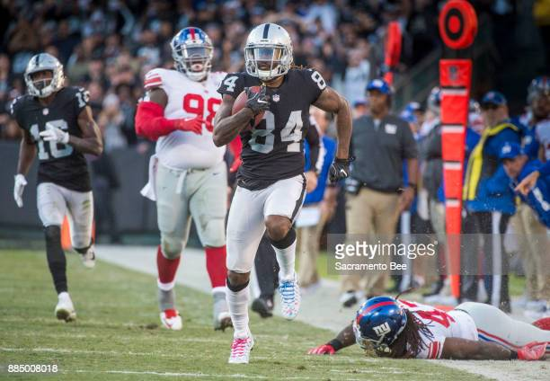 Oakland Raiders wide receiver Cordarrelle Patterson makes his way near the goal line as he leaves New York Giants defenders behind on Sunday Dec 3...