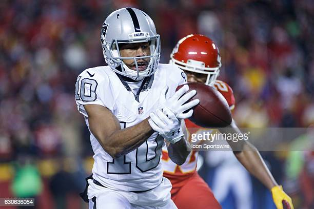 Oakland Raiders wide receiver Seth Roberts bobbles the ball during the NFL AFC West division football game between the Oakland Raiders and the Kansas...