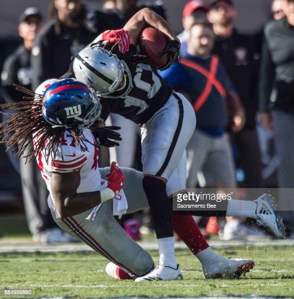 Oakland Raiders wide receiver Seth Roberts is taken down after he made a first down against New York Giants linebacker Kelvin Sheppard on Sunday Dec...