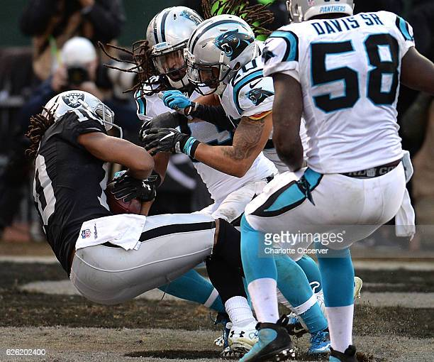 Oakland Raiders wide receiver Seth Roberts left catches a twopoint conversion pass from quarterback Derek Carr as the Carolina Panthers defense...