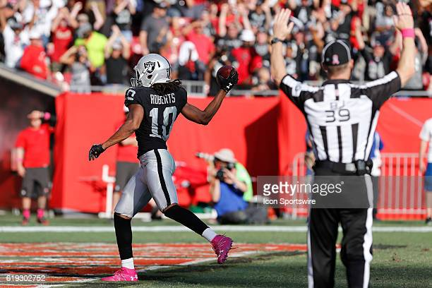 Oakland Raiders wide receiver Seth Roberts runs into the end zone for a touchdown in overtime of the NFL game between the Oakland Raiders and Tampa...