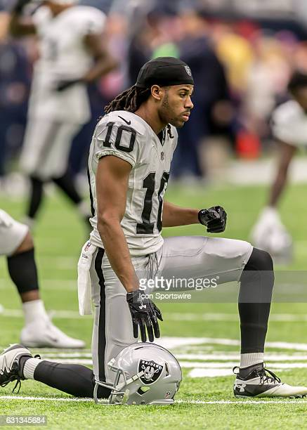Oakland Raiders wide receiver Seth Roberts warms up during the NFL AFC Wild Card game between the Oakland Raiders and Houston Texans on January 7 at...