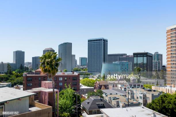 oakland skyline , day and night series - oakland california skyline stock pictures, royalty-free photos & images