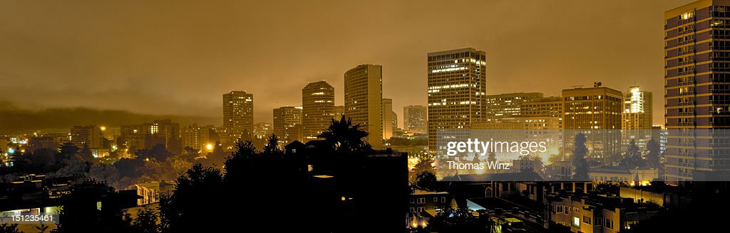 Oakland skyline in fog at night : Stock Photo