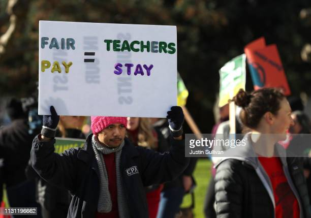 Oakland Unified School District students and teachers carry signs as they picket outside of Oakland Technical High School on February 21 2019 in...