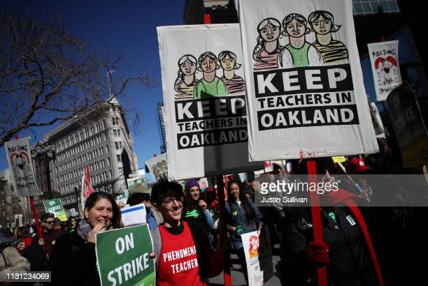 Oakland Unified School District students teachers and parent carry signs as they march to the Oakland Unified School District headquarters on...