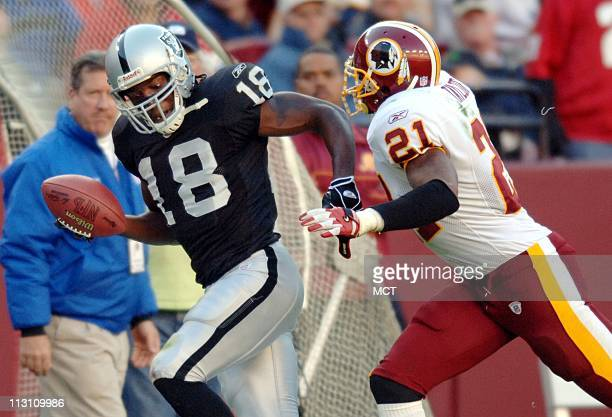 LANDOVER MD Oakland wide receiver Randy Moss carries the ball for extra yardage as he is chased by Washington free safety Sean Taylor during the...