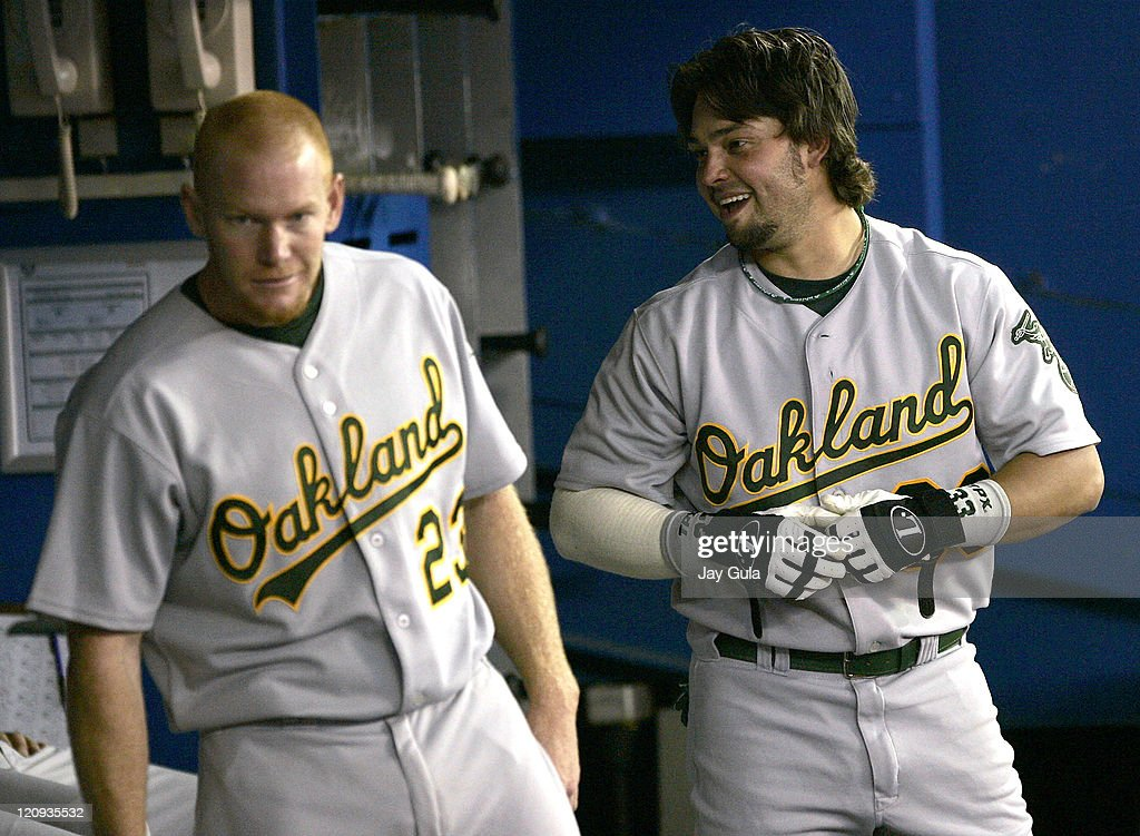 Oakland's Nick Swisher jokes around with teammate Bobby Kielty in the dugout after hitting his 2nd HR of the game vs the Toronto Blue Jays in MLB action at Rogers Centre in Toronto, Canada on May 11, 2006.