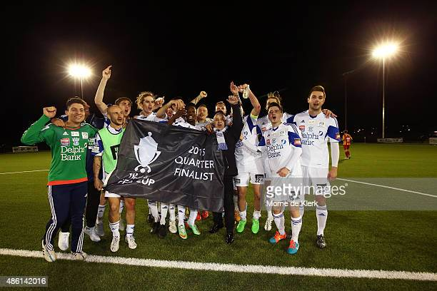 Oakleigh Cannons celebrates with their winning flag after winning the FFA Cup Round of 16 match between MetroStars and Oakleigh Cannons at Elite...