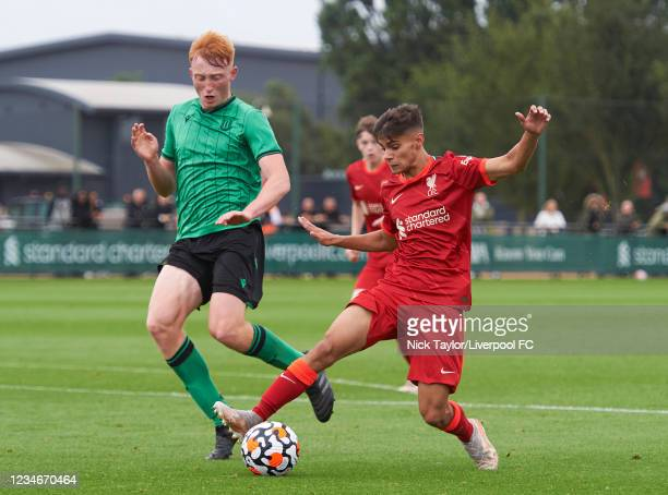 Oakley Cannonier of Liverpool and Josh Roney of Stoke City in action during the U18 Premier League game at AXA Training Centre on August 14, 2021 in...