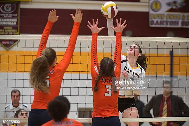 Oakton Cougars Grace Cozad goes for the kill between West Springfield Spartans Hailey Olsen and West Springfield Spartans Sara Khatouri in the third...