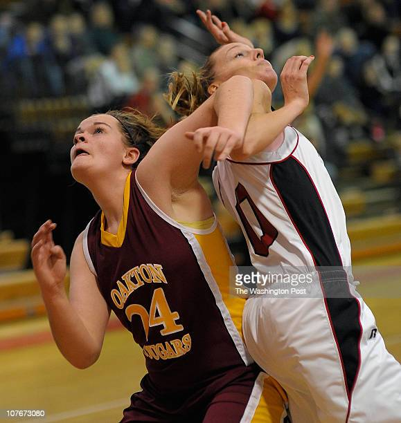 oakton's Elizabeth Manner left and Madison's Anna Jay position themselves under the basket for a rebound as Oakton defeats Madison 57 46 in girls...