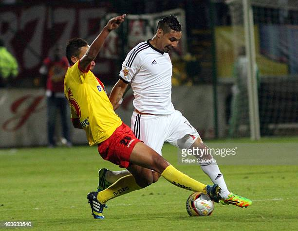 Oaldier Morales of Bogota FC struggles for the ball with Bryan Uruena of America de Cali during a match between Bogota and America de Cali as part of...