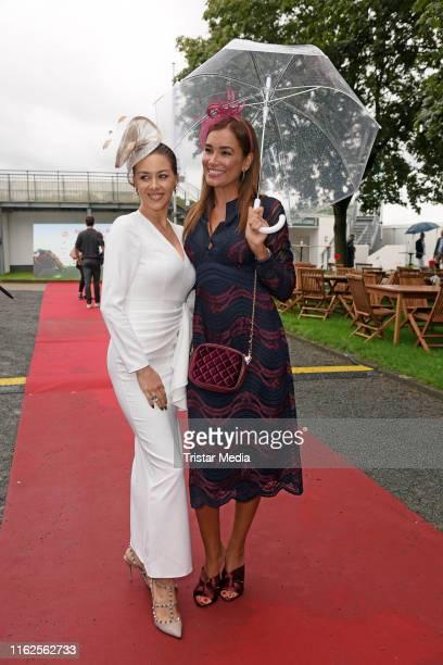 Oana Nechiti and Jana Ina Zarrella attend the Audi Ascot Race Day at Neue Bult horse racing track on August 18 2019 in Langenhagen Germany