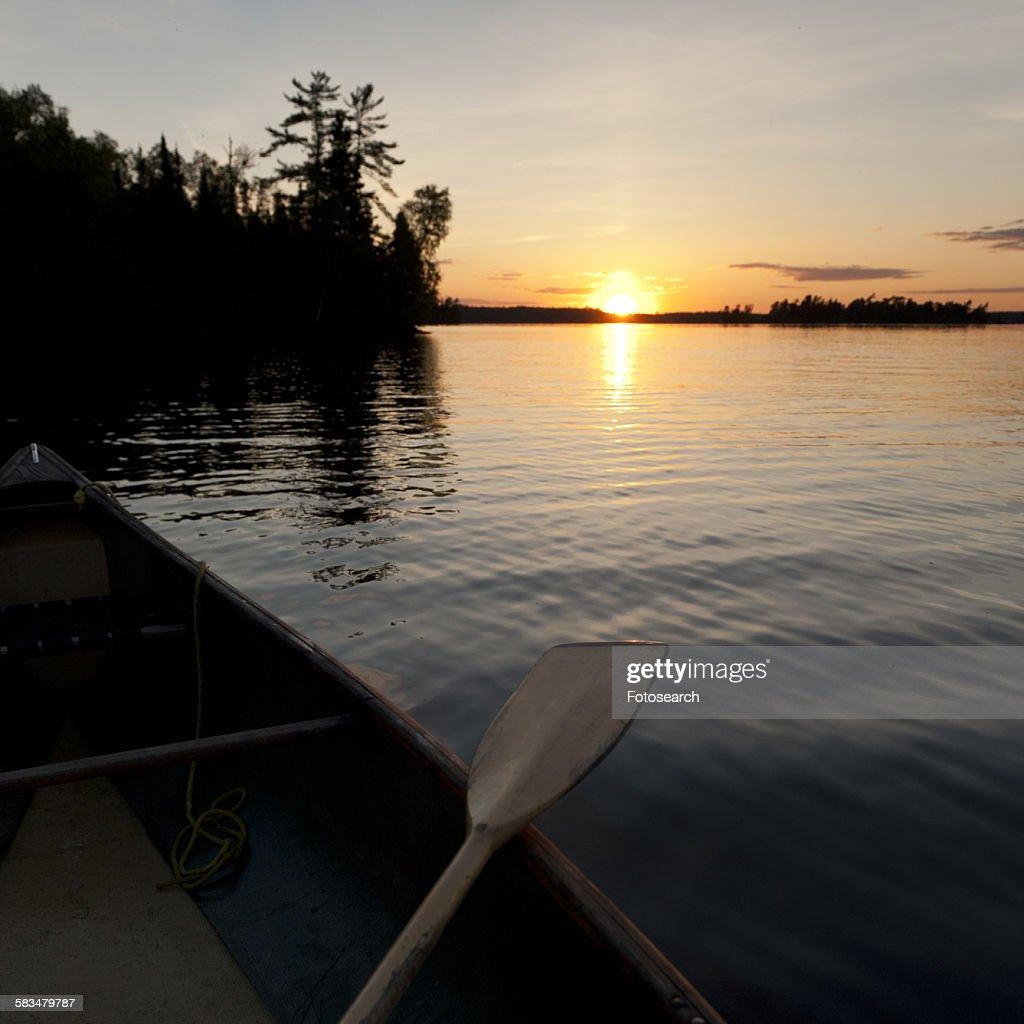 Oar on a canoe in a lake : Stock Photo