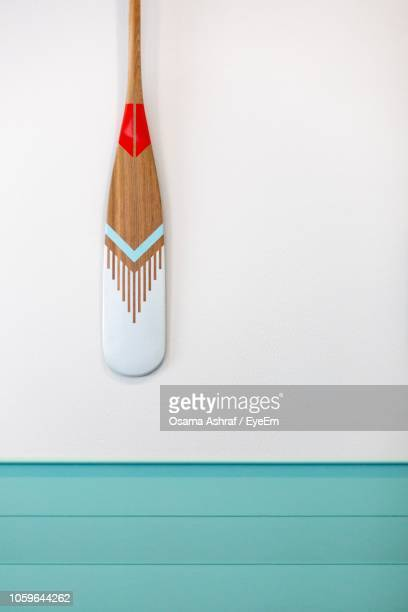 oar on white wall - paddle stock pictures, royalty-free photos & images
