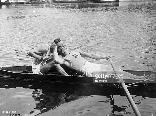 Oarsmen Ercole Olgeni and Giovanni Scatturin kiss after winning the gold medal in rowing at the 1920 Olympic Games