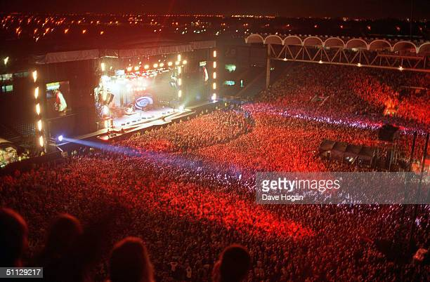 Oasis on stage at Manchester City's football ground Maine Road