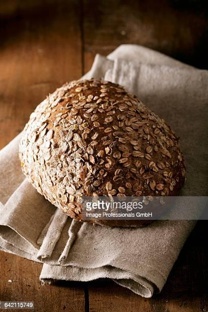 Oat bread loaf on a tea towel