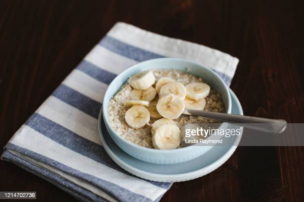 oatmeal, banana, cream and maple syrup - oatmeal stock pictures, royalty-free photos & images
