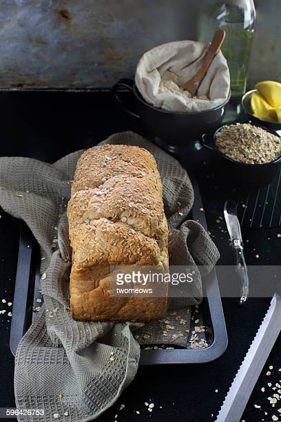 Oatmeal bread loaf on moody bakery background