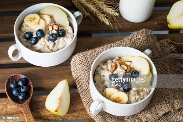 oatmeal porridge, healthy breakfast food - oatmeal stock photos and pictures