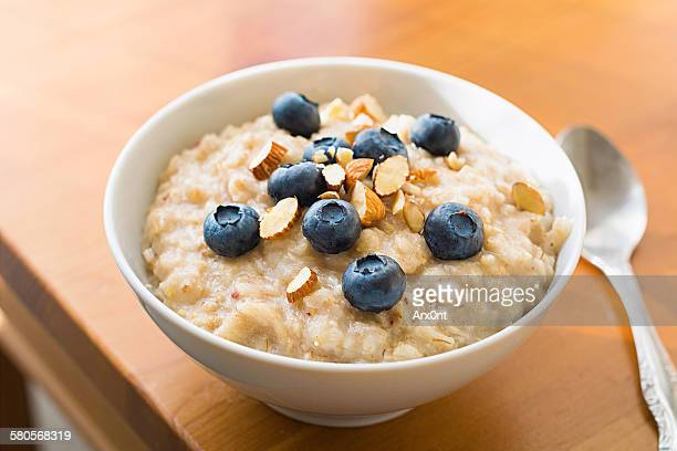 oatmeal porridge - rolled oats stock photos and pictures